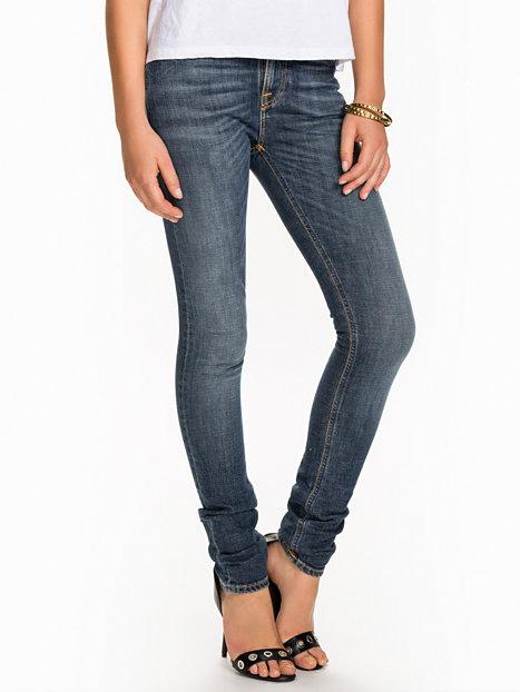 Hình ảnh quần jean nữ tối màu dáng ôm